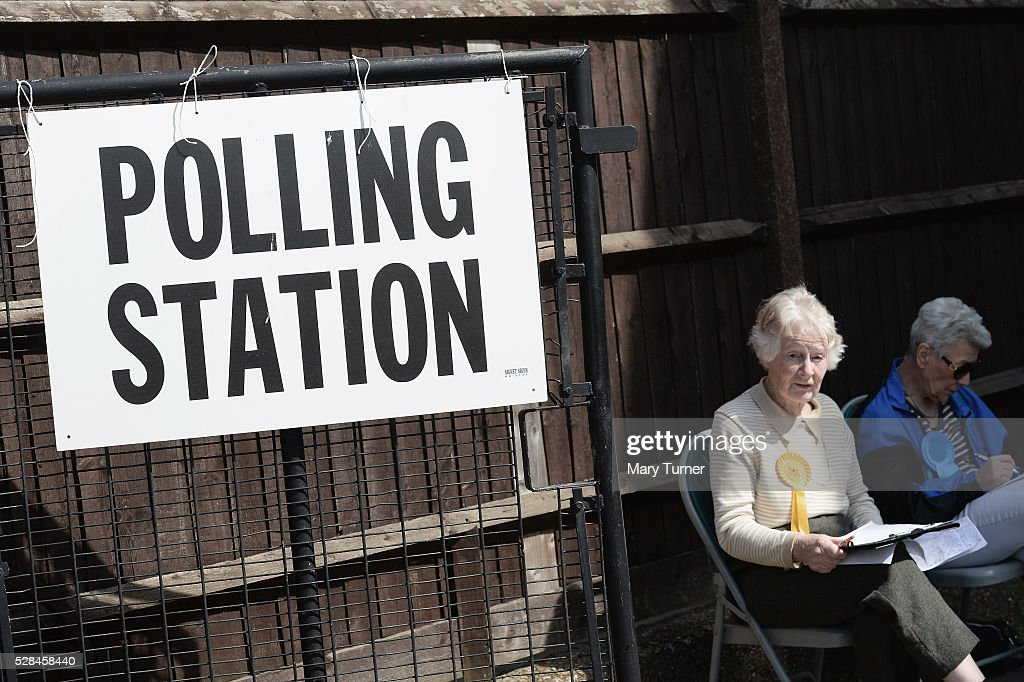 Telling agents wait to help voters as they arrive at the St Agnes Centre in Barnet, North London to register their votes in the Mayoral and Assembly elections on May 5, 2016 in Barnet, United Kingdom. There have been problematic issues throughout the day in the North London borough due to registration issues. Today, dubbed 'Super Thursday',sees the British public vote in countrywide elections to choose members for the Scottish Parliament, the Welsh Assembly, the Northern Ireland Assembly, Local Councils, a new London Mayor and Police and Crime Commissioners. There are around 45 million registered voters in the UK and polling stations open from 7am until 10pm.