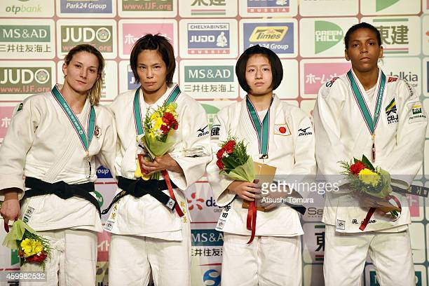 Telma Monteiro of Portugal Kaori Matsumoto of Japan Rafaela Silva of Brazil and Tsukasa Yoshida of Japan pose in the victory ceremony for Women's...