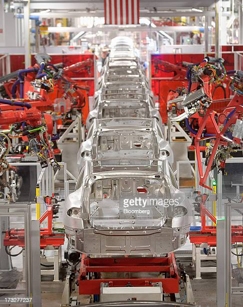 Telsa Motor Inc Model S sedans make their way along a robotic assembly line at the company's assembly plant in Fremont California US on Wednesday...