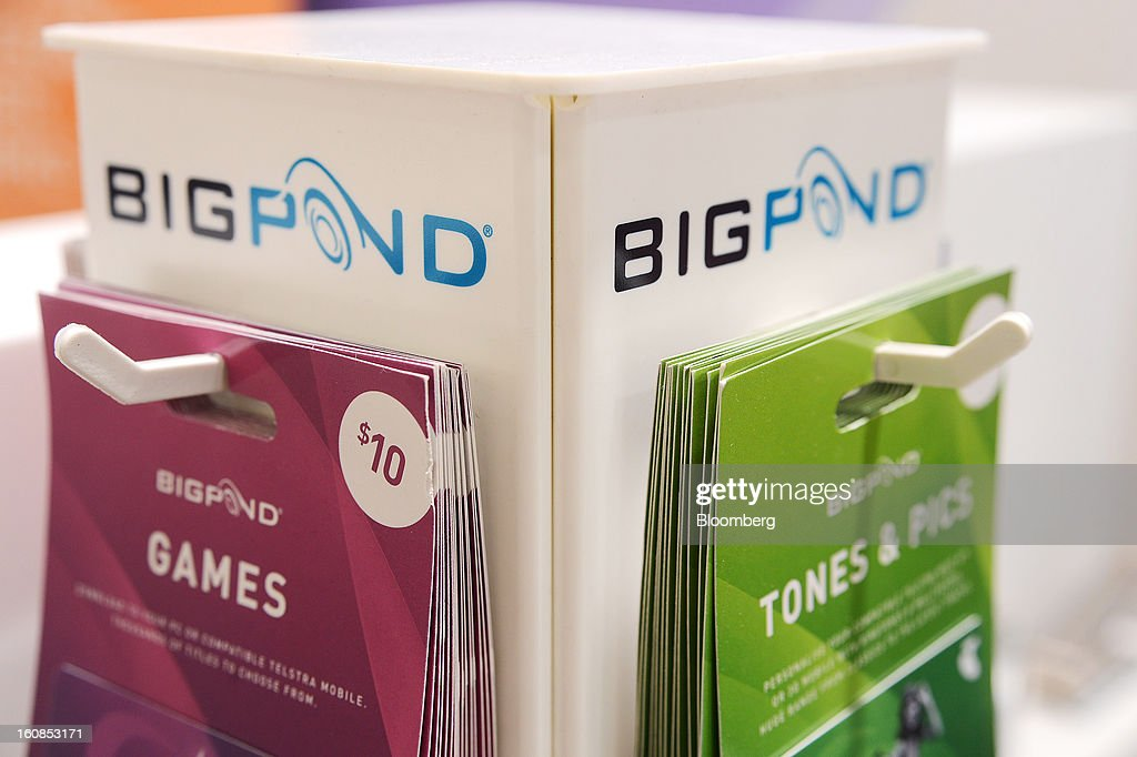 Telstra Corp. BigPond gift cards are displayed for sale at a Telstra retail outlet in Melbourne, Australia, on Thursday, Feb. 7, 2013. Telstra Corp., Australia's largest phone company, posted first-half profit that matched analyst estimates as it added 607,000 new mobile customers. Photographer: Carla Gottgens/Bloomberg via Getty Images