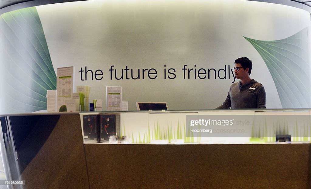 A Telus Corp. representative waits to assist customers at a learning center and store in Toronto, Ontario, Canada, on Wednesday, Feb. 13, 2013. Telus Corp. is scheduled to release earnings data on Feb. 15. Photographer: Aaron Harris/Bloomberg via Getty Images