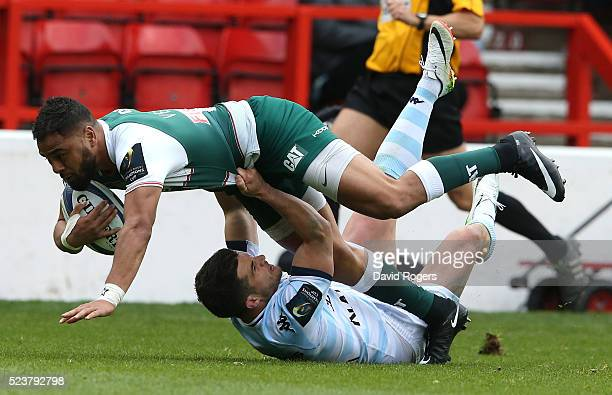 Telusa Veainu of Leicester is tackled by Brice Dulin during the European Rugby Champions Cup semi final match between Leicester Tigers and Racing 92...