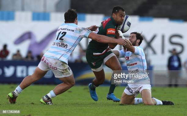 Telusa Veainu of Leicester is tackled by Henry Chavancy and Maxime Machenaud during the European Rugby Champions Cup match between Racing 92 and...