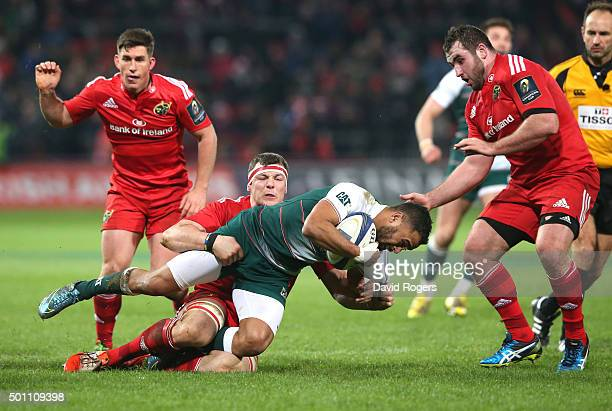 Telusa Veainu of Leicester is tackled by Robin Copeland during the European Rugby Champions Cup match between Munster and Leicester Tigers at Thomond...