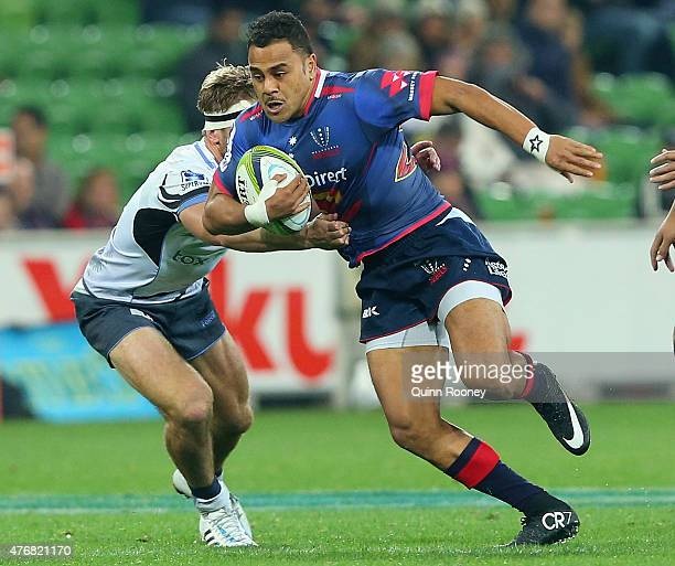 Telusa Veainu of the Rebels breaks through a tackle during the round 18 Super Rugby match between the Rebels and the Force at AAMI Park on June 12...
