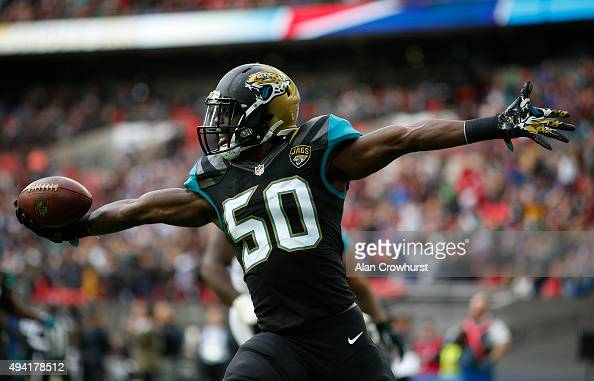 Telvin Smith of Jacksonville Jaguars scores a touchdown in the second quarter on an interception in the second quarter during the NFL game between...