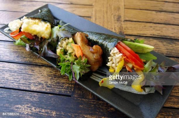 Temaki susuhi rolls including fried halloumi cheese tempura, vegetables, and chicken teriyaki