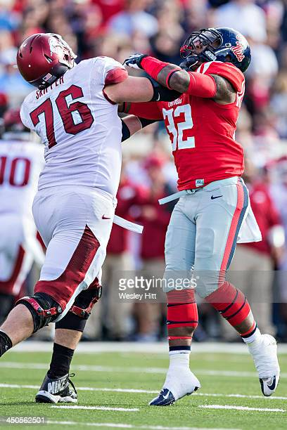 Temario Strong of the Ole Miss Rebels is blocked by Dan Skipper of the Arkansas Razorbacks at VaughtHemingway Stadium on November 9 2013 in Oxford...