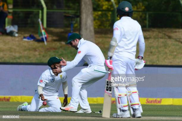Temba Bavuma and Dean Elgar of the Proteas celebrate the wicket of Mushfiqur Rahim of Bangladesh during day 2 of the 2nd Sunfoil Test match between...