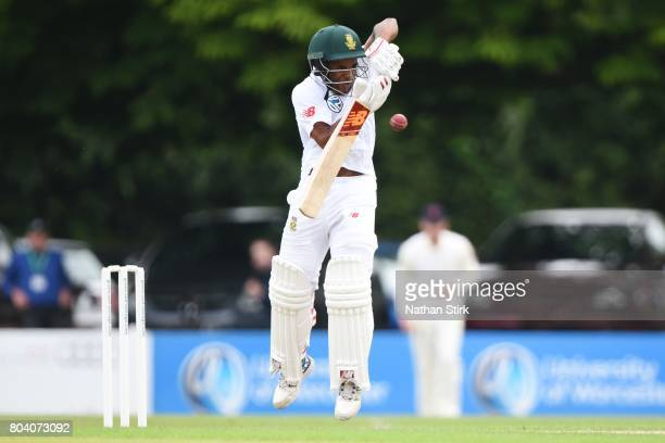 Temba Bavuma of South Africa A defends the ball during the tour match between England Lions and South Africa A at New Road on June 30 2017 in...