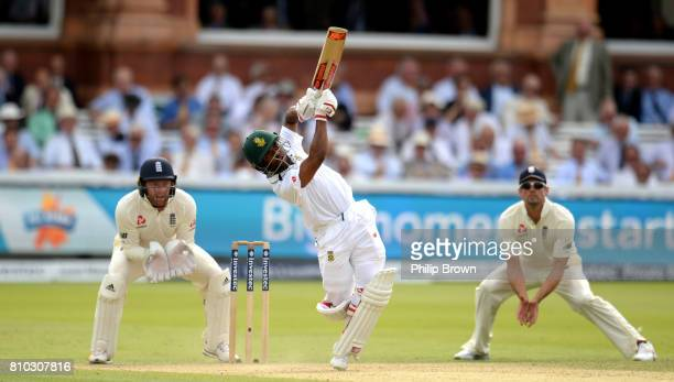 Temba Bavuma of South Africa hits out watched by Jonny Bairstow and Alastair Cook of England during day two of the 1st Investec Test match between...