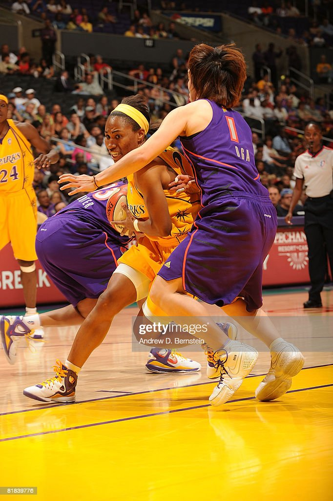 Temeka Johnson of the Los Angeles Sparks drives the ball during the game against Yuko Oga of the Phoenix Mercury on July 6 2008 at Staples Center in...