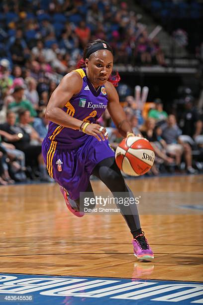 Temeka Johnson of the Los Angeles Sparks drives to the basket against the Minnesota Lynx on August 9 2015 at Target Center in Minneapolis Minnesota...