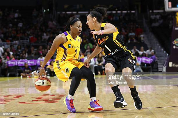 Temeka Johnson of the Los Angeles Sparks handles the ball against Brianna Kiesel of the Tulsa Shock in a WNBA game at Staples Center on August 6 2015...