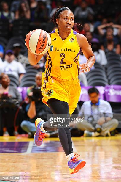 Temeka Johnson of the Los Angeles Sparks handles the ball against the Seattle Storm at Staples Center on August 11 2015 in Los Angeles California...