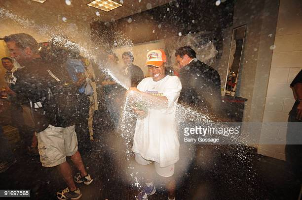 Temeka Johnson of the Phoenix Mercury celebrates with champagne after defeating the Indiana Fever 9486 in Game five of the WNBA Finals played on...