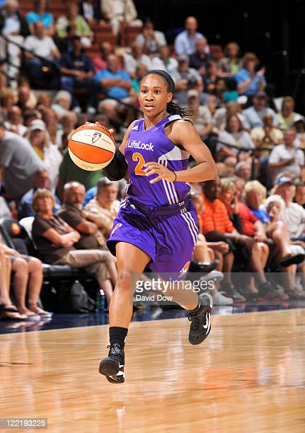 Temeka Johnson of the Phoenix Mercury drives the basketball against the Connecticut Sun on August 26 2011 at the Mohegan Sun Arena in Uncasville...