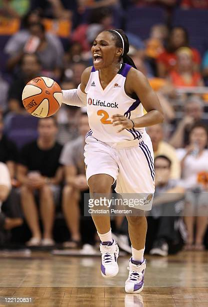 Temeka Johnson of the Phoenix Mercury handles the ball during the WNBA game against the New York Liberty at US Airways Center on August 23 2011 in...