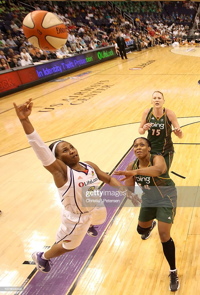 Temeka Johnson #2 of the Phoenix Mercury lays up a shot past Le'coe Willingham #34 of the Seattle Storm during the WNBA game at US Airways Center on July 14, 2010 in Phoenix, Arizona.The Storm defeated the Mercury 111-107 in triple overtime.