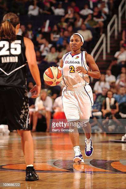Temeka Johnson of the Phoenix Mercury moves the ball against Becky Hammon of the San Antonio Silver Stars during Game One of the 2010 WNBA Western...