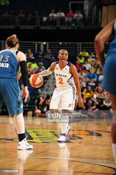 Temeka Johnson of the Phoenix Mercury moves the ball against the Minnesota Lynx during the WNBA game on July 20 2011 at US Airways Center in Phoenix...