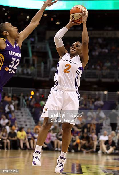 Temeka Johnson of the Phoenix Mercury puts up a shot against the Los Angeles Sparks during the WNBA game at US Airways Center on September 3 2011 in...