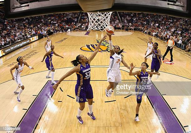 Temeka Johnson of the Phoenix Mercury puts up a shot during the WNBA game against the Los Angeles Sparks at US Airways Center on September 3 2011 in...