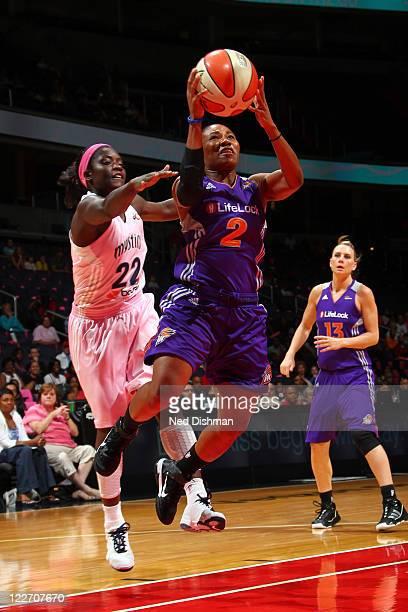 Temeka Johnson of the Phoenix Mercury shoots against Matee Ajavon of the Washington Mystics at the Verizon Center on August 28 2011 in Washington DC...
