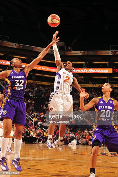Temeka Johnson of the Phoenix Mercury shoots against Tina Thompson of the Los Angeles Sparks on September 3 2011 at US Airways Center in Phoenix...