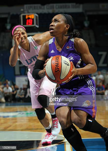 Temeka Johnson of the Phoenix Mercury takes the ball down the court during the game against the Minnesota Lynx on August 2 2011 at Target Center in...