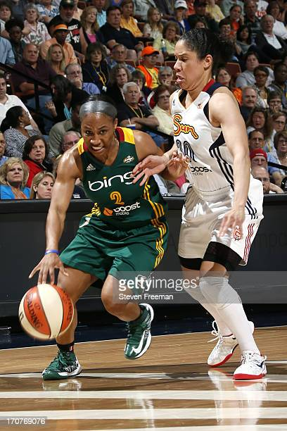 Temeka Johnson of the Seattle Storm brings the ball up court against the Connecticut Sun on June 16 2013 at Mohegan Sun Arena in Uncasville...