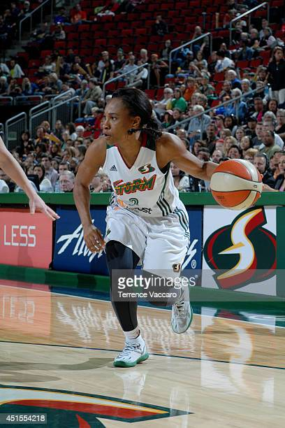 Temeka Johnson of the Seattle Storm drives against the Minnesota Lynx on June 27 2014 at Key Arena in Seattle Washington NOTE TO USER User expressly...