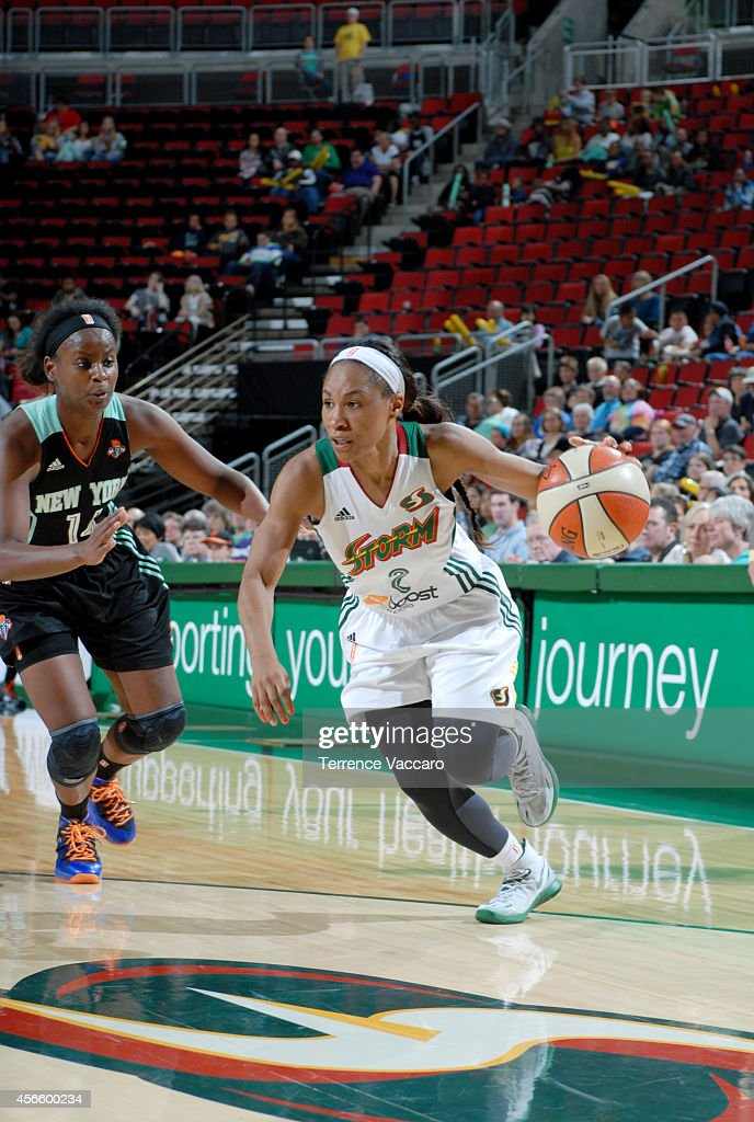 <a gi-track='captionPersonalityLinkClicked' href=/galleries/search?phrase=Temeka+Johnson&family=editorial&specificpeople=217716 ng-click='$event.stopPropagation()'>Temeka Johnson</a> #2 of the Seattle Storm drives against the New York Liberty on July 24,2014 at Key Arena in Seattle, Washington.