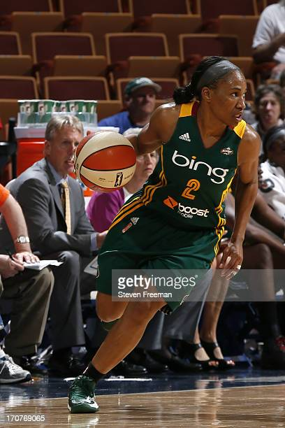 Temeka Johnson of the Seattle Storm drives to the basket against the Connecticut Sun on June 16 2013 at Mohegan Sun Arena in Uncasville Connecticut...