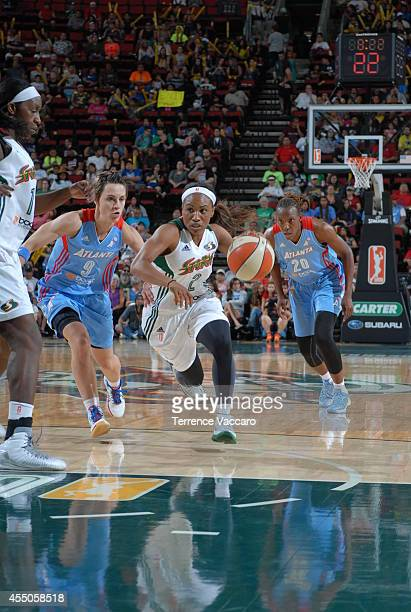 Temeka Johnson of the Seattle Storm drives to the basket against the Atlanta Dream during the game on August 72014 at Key Arena in Seattle Washington...
