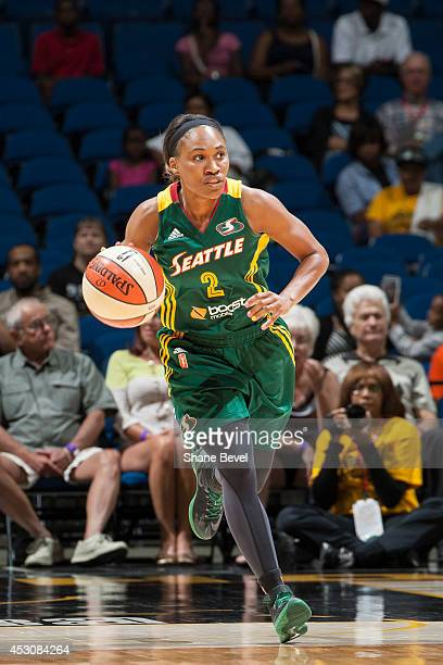 Temeka Johnson of the Seattle Storm handles the ball against the Tulsa Shock during the WNBA game on July 29 2014 at the BOK Center in Tulsa Oklahoma...