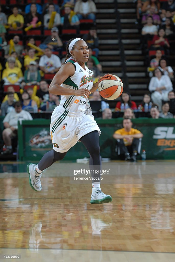 Temeka Johnson #2 of the Seattle Storm handles the ball against the Phoenix Mercury during the game on August 17, 2014 at Key Arena in Seattle, Washington.