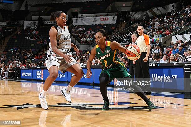 Temeka Johnson of the Seattle Storm handles the basketball while being guarded by Jia Perkins of the San Antonio Stars at ATT Center on June 13 2014...