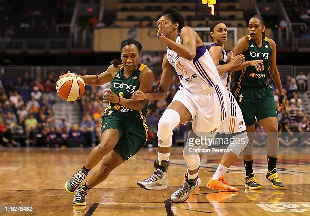 Temeka Johnson of the Seattle Storm moves the ball past Briana Gilbreath of the Phoenix Mercury during the WNBA game at US Airways Center on August...
