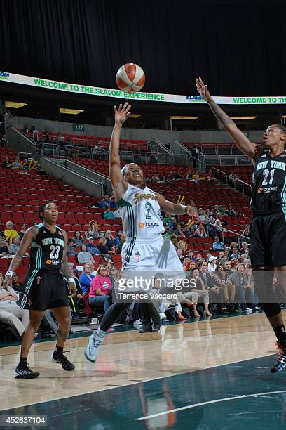 Temeka Johnson of the Seattle Storm shoots against Alex Montgomery#21 of the New York Liberty during the game on July 242014 at Key Arena in Seattle...
