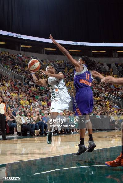 Temeka Johnson of the Seattle Storm shoots against Alexis Hornbuckle of the Phoenix Mercury during a WNBA game on June 2 2013 at Key Arena in Seattle...