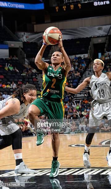 Temeka Johnson of the Seattle Storm shoots against Danielle Robinson of the San Antonio Silver Stars at the ATT Center on June 21 2013 in San Antonio...