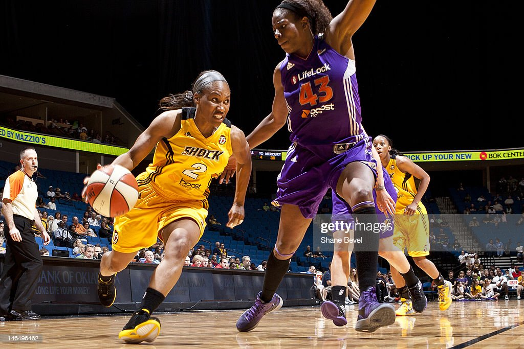 Temeka Johnson of the Tulsa Shock drives to the basket against Nakia Sanford of the Phoenix Mercury during the WNBA game on June 17 2012 at the BOK...