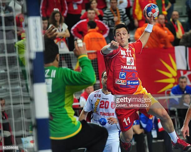 Temelkov Vladimir from Macedonia shoots against Tunisia during the Men's World Handball Championship match on January 17 in Varazdin Hosts Croatia...