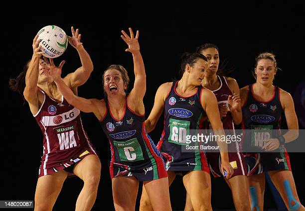Temepara George of the Mystics and Chelsey Tregear of the Vixens compete for the ball during the Major Semi Final ANZ Championship match between the...