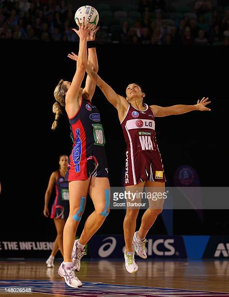 Temepara George of the Mystics and Julie Corletto of the Vixens compete for the ball during the Major Semi Final ANZ Championship match between the...