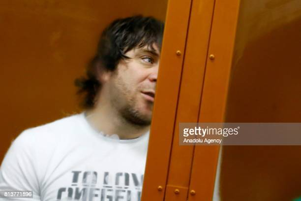 Temirlan Eskerkhanov who is convicted of organizing and carrying out the contract killing of opposition leader Boris Nemtsov is seen inside a glass...