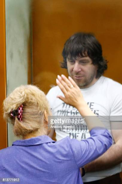 Temirlan Eskerkhanov who is convicted of organizing and carrying out the contract killing of opposition leader Boris Nemtsov stand inside a glass...