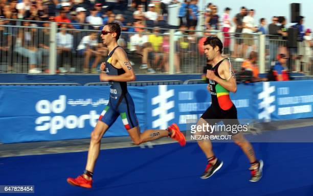 Temirlan Temirov of Kazakhstan and Miguel Arraiolos from Portugal compete in the ITU World Triathlon at the Yas Marina Circuit in Abu Dhabi on March...