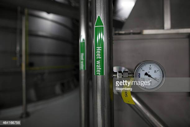A temperature gauge reads 62 degrees centigrade beside a water pipe on giant yeast extract drying chambers at the Royal DSM NV site in Delft...